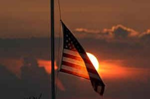 American_Flag_Half_Mast_at_Sunset-301x198